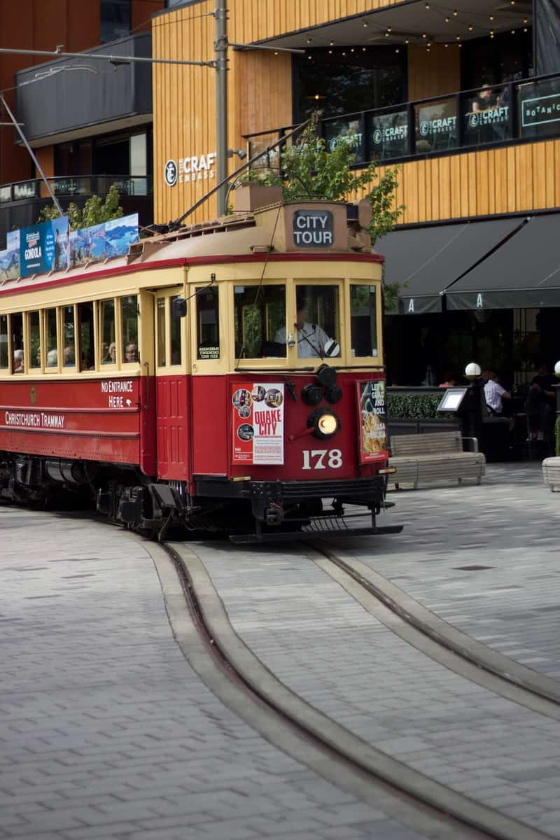 red and white tram on road during daytime